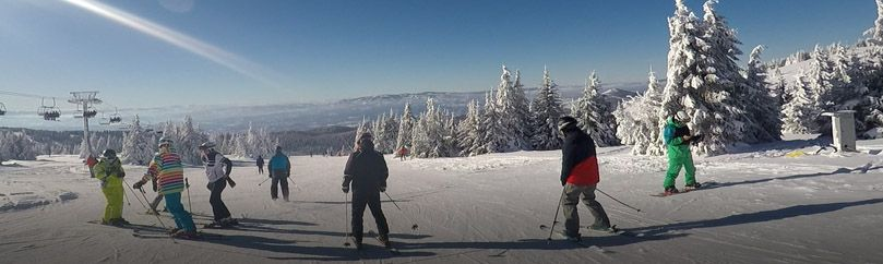 Group of skiers enjoy skiing at Kopaonik