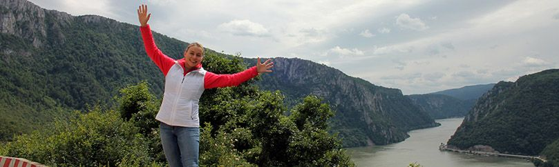 Girl in red shirt is standing on the edge of the iron gate gorge in Serbia.