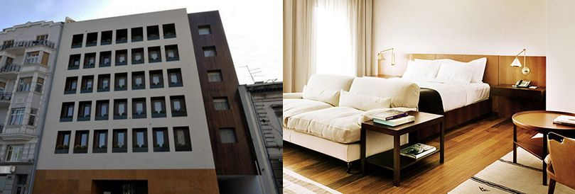 Modern building of Square Nine hotel has elegant room interior.