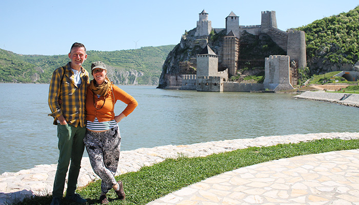 Couple is posing in front of the Golubac fortress as one of the Serbian top five destinations.